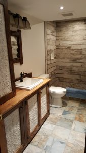 Slate-look, porcelain tile on floor in rustic bathroom.